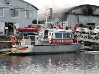 FireStorm 30 supplying water during a four-alarm fire New England Boatworks shipyard in Portsmouth, RI